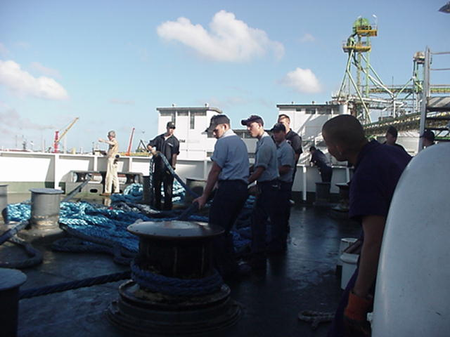 Feeding the winch.: Freshmen cadets tend the winch aft during undocking evolutions in Curacao.