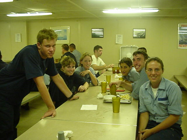 Messdeck.jpg: Cadets at dinner after the drills: 2/c Mark Weissman, Wouburn,MA; 3/c Kaitlyn Flynn, S.Boston,MA; 2/c Katie Coan,Brimfield,MA; 3/c Angela Abbot, Sandwich,MA; 1/c Dennis Kenny, Andover,MA; and 3/c Mary Gagnon, S.Boston,MA.